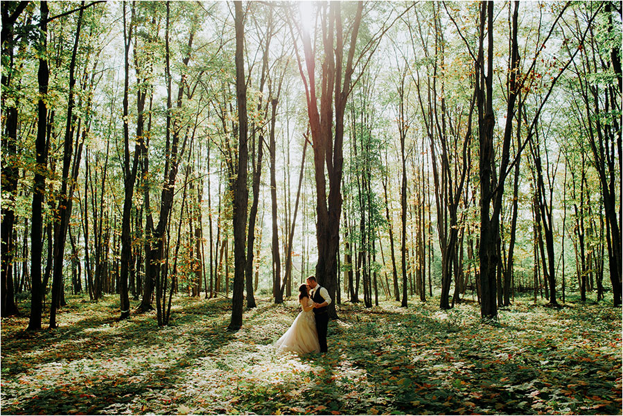 bride and groom kiss among the trees on manitoulin island