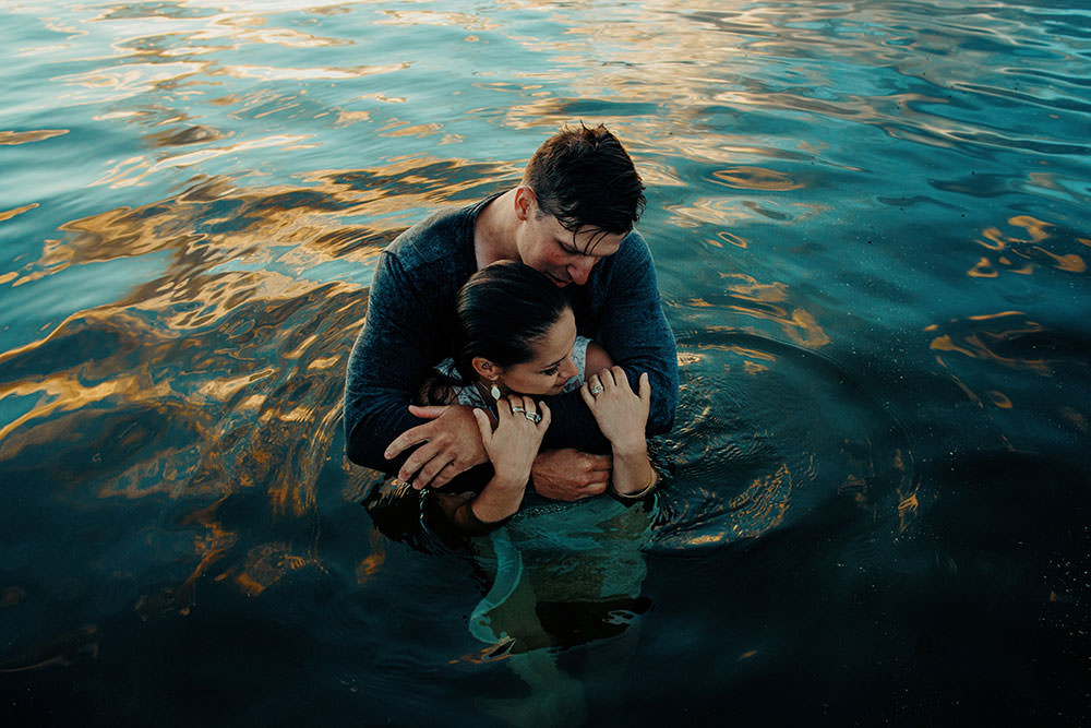 sudbury couple embraces while swimming in water