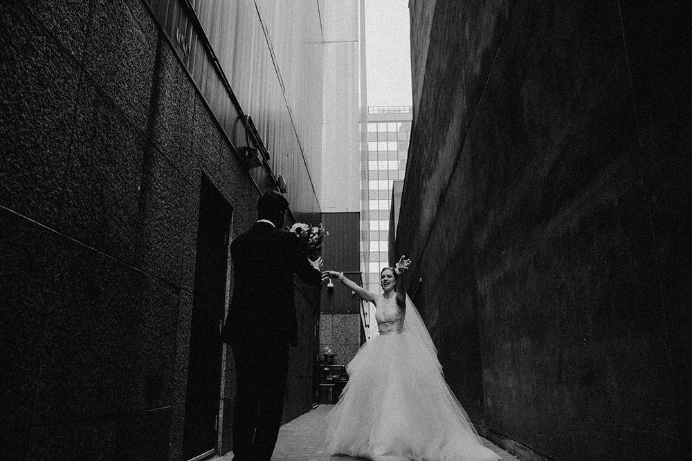 bride and groom pose downtown toronto