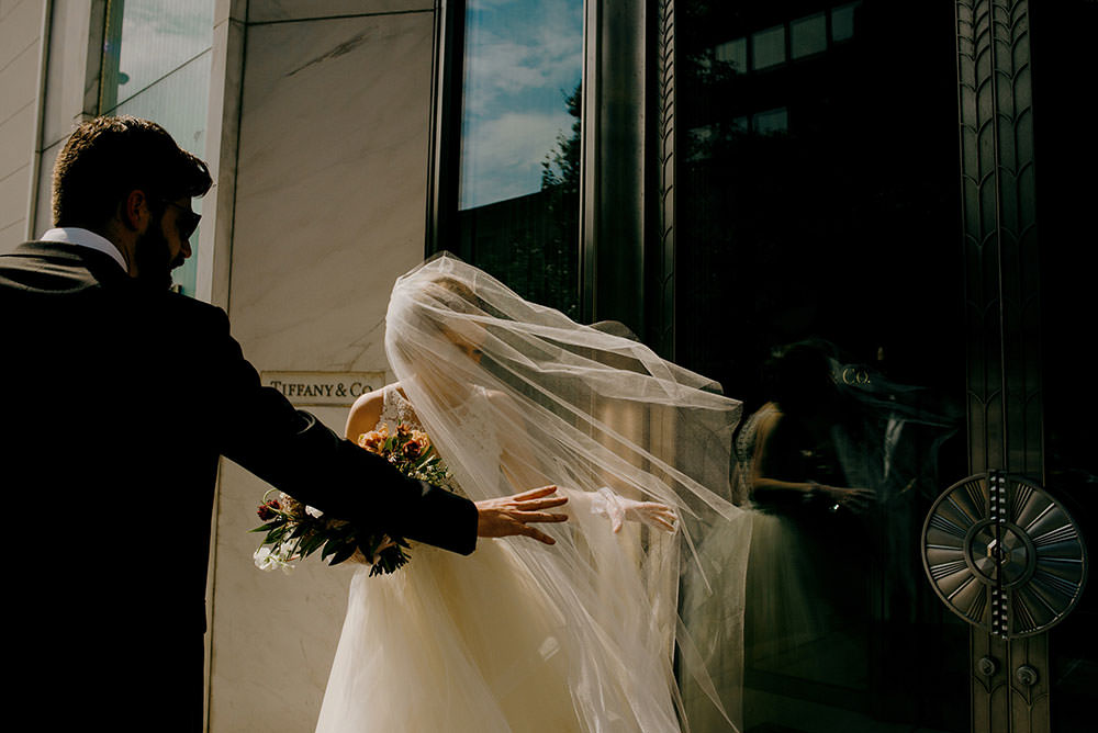 bridej's veil flies in wind downtown toronto