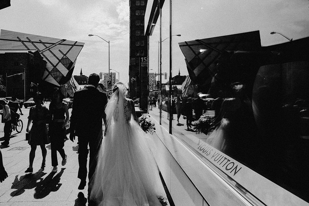 bride and groom walk around downtown toronto