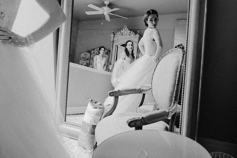 bride looks at her reflection
