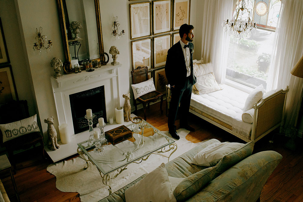 groom waits in elegant room
