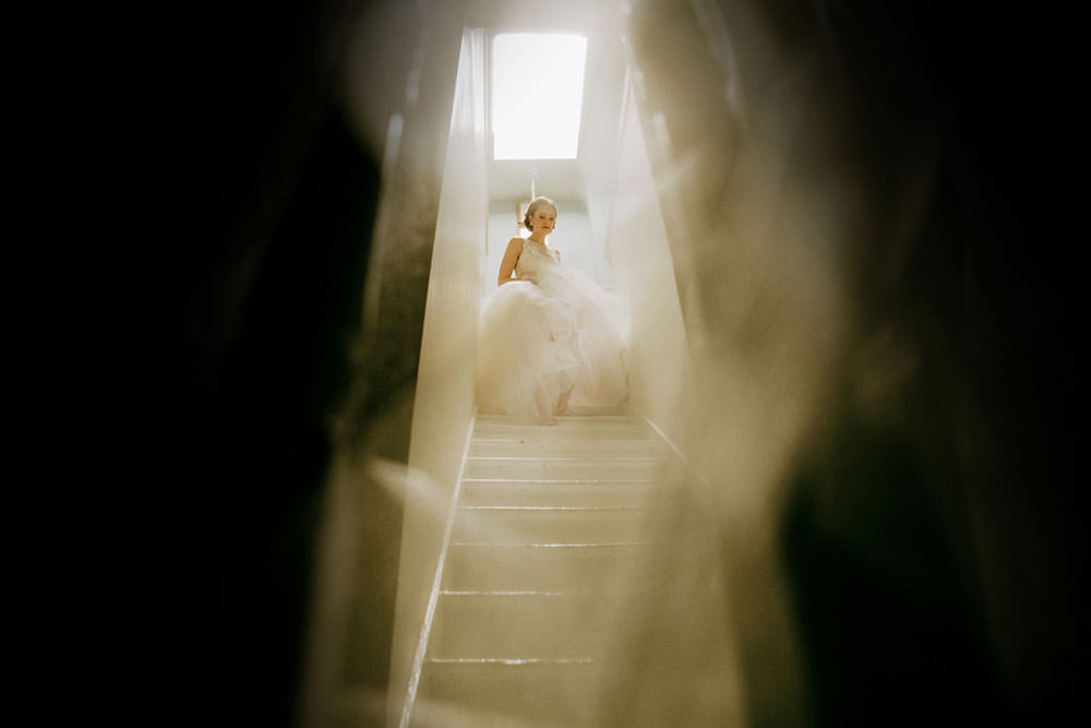 bride begins going down stairs