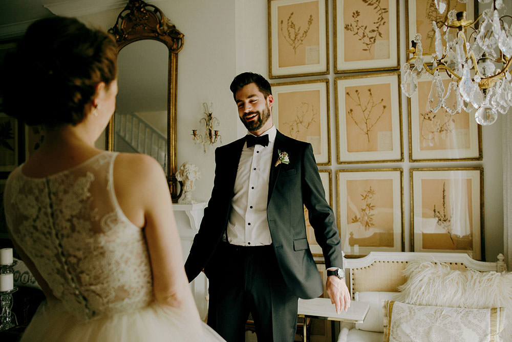 groom looks at bride for the first time on wedding day