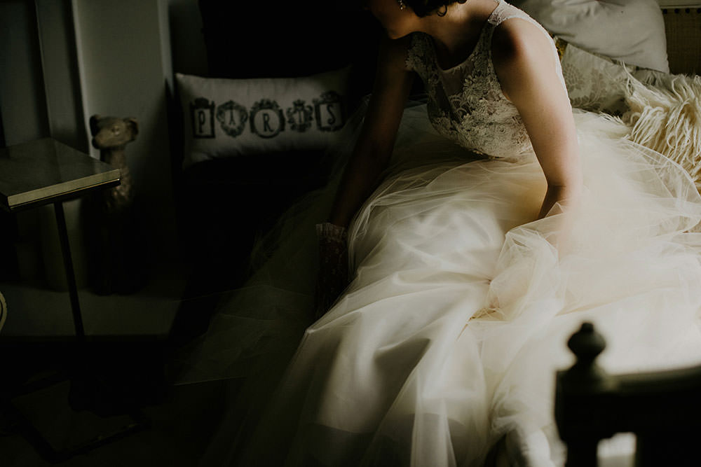 bride fluffs gown after sitting