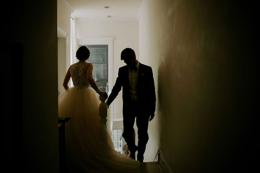 bride and groom climb stairs