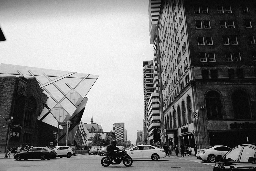 motorcycle drives by Toronto ROM