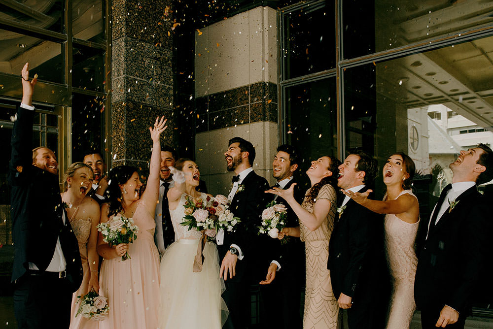bridal party throws glitter up in air