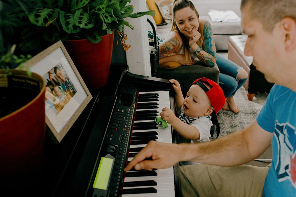 sudbury family portrait kid playing piano