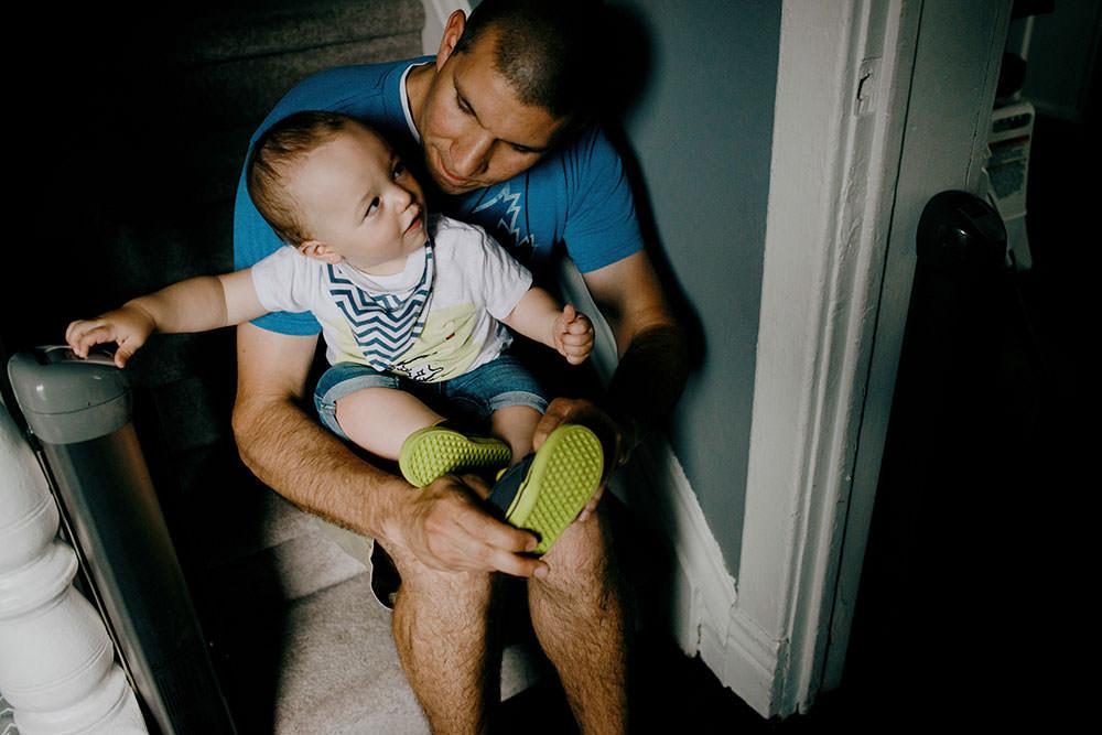 sudbury family portrait dad puts on boys shoe