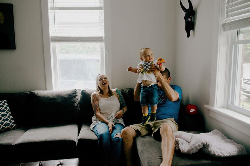 sudbury family portrait mom and dad kissing baby boy