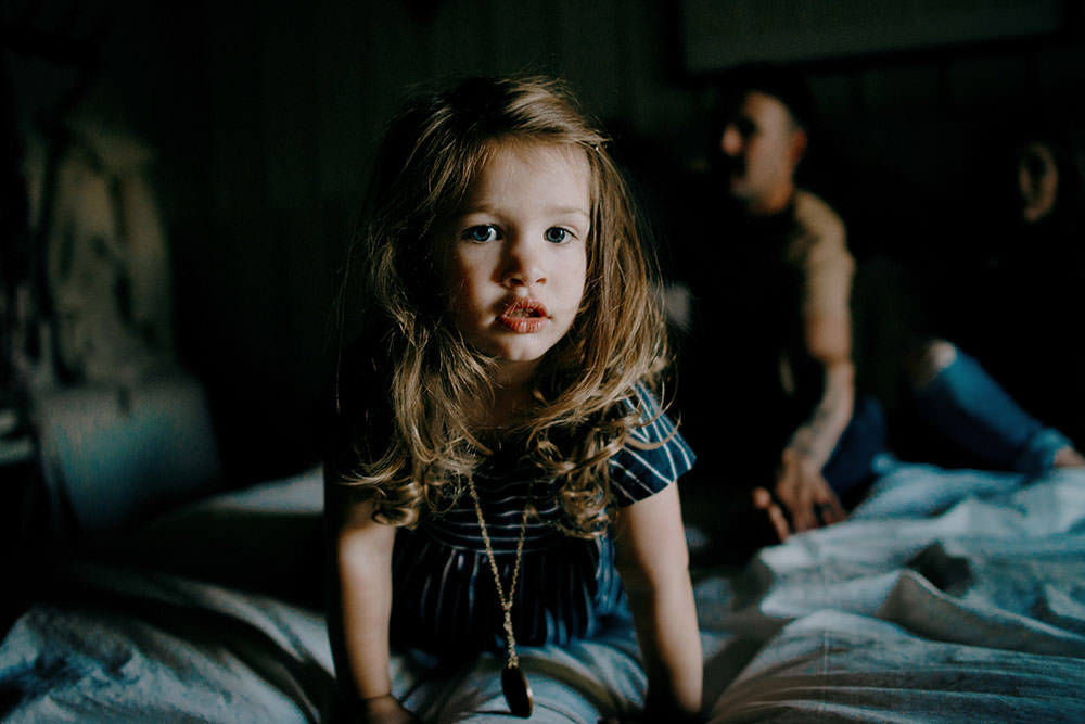 sudbury family portrait girl jumps on bed