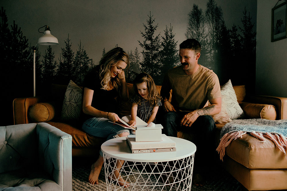 cute family plays on couch