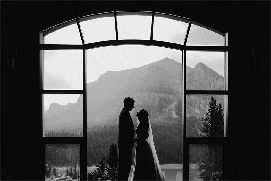 Wedding Couple in front of the mountains at the Fairmont Chateau Lake Louise wedding photography