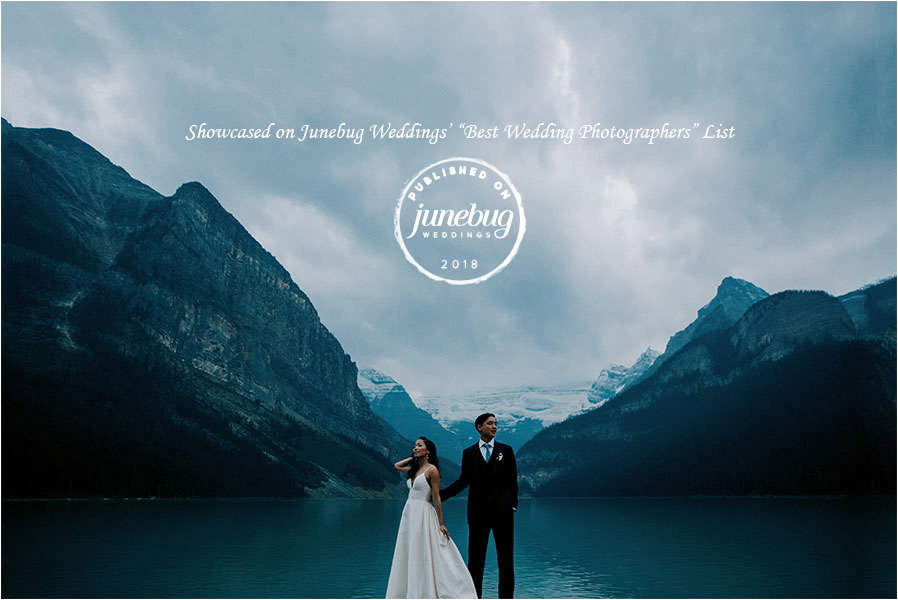 bride and groom stand together with lake louise and mountains behind them