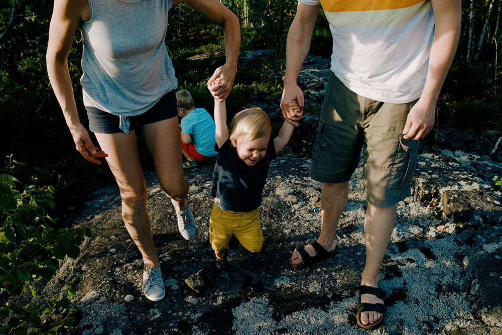 family walks on hiking trail in summer family portrait