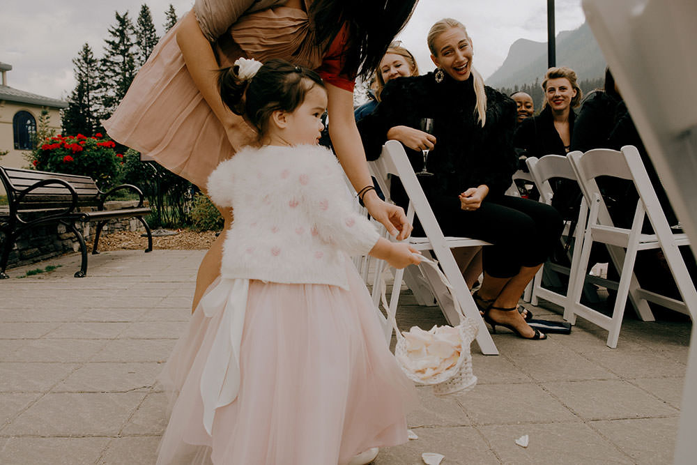 Flower girl walks down the aisle at the Fairmont Chateau Lake Louise