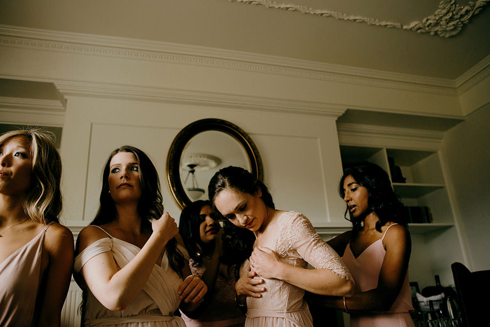 bridesmaids getting ready in hotel room at the Fairmont Chateau Lake Louise