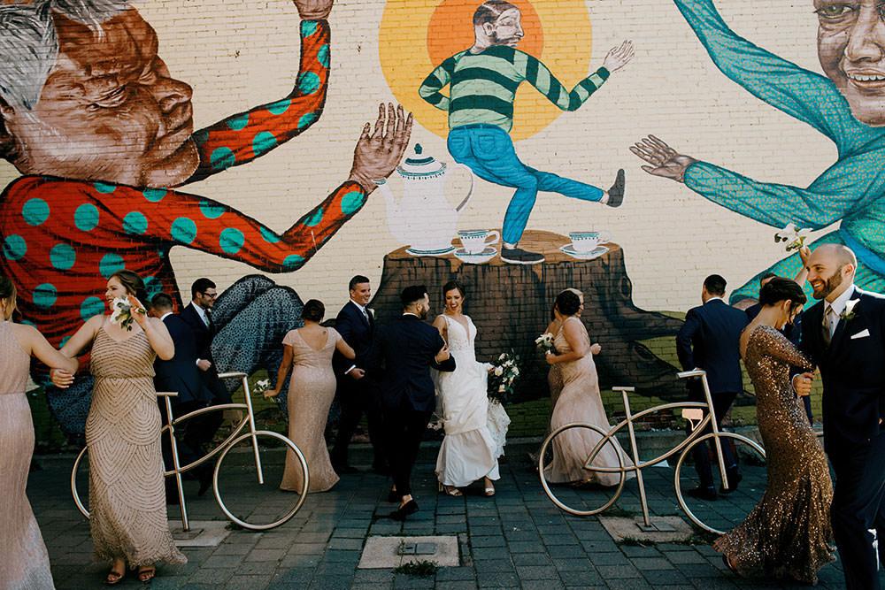 dancing in front of Mural in Sudbury
