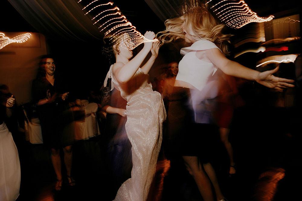 Chest bump at wedding reception at Caruso Club in Sudbury