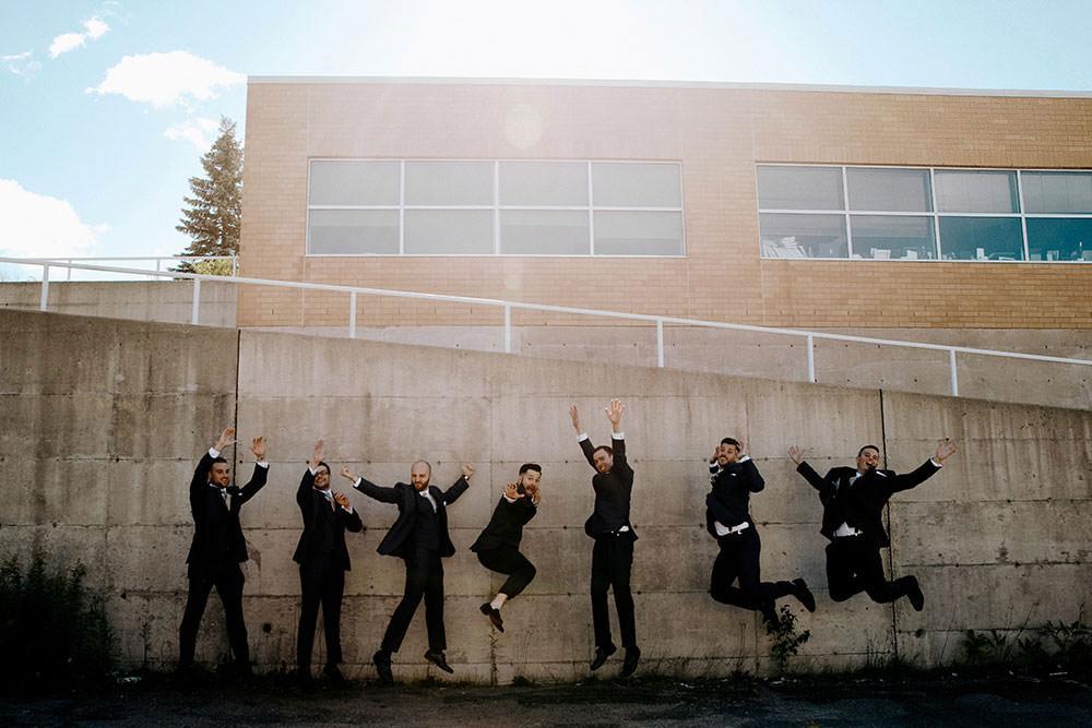The groomsmen jumping at wedding in Sudbury