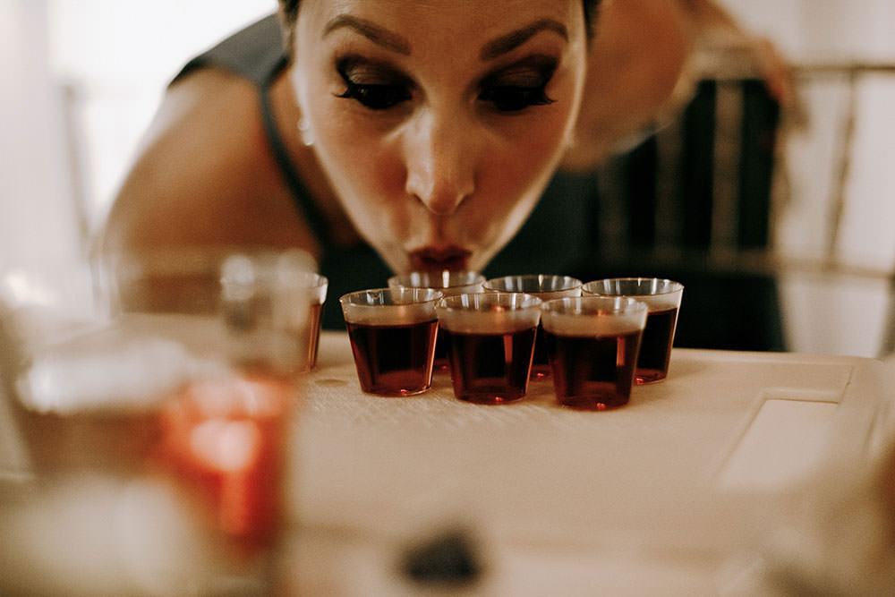 woman takes sip of shot glass at Sudbury wedding