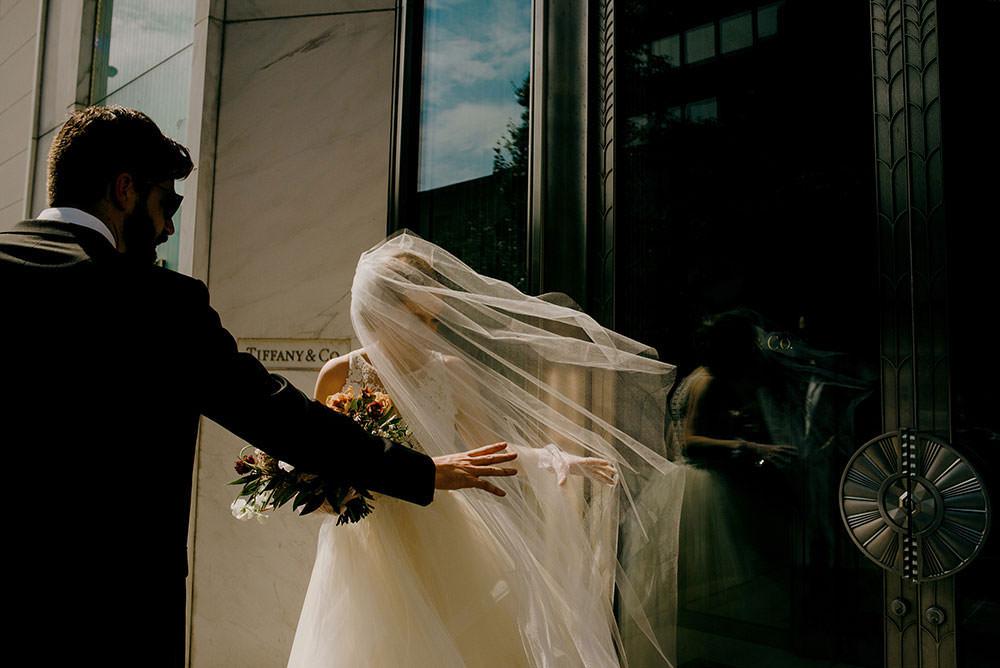 Bride veil flies in the wind in downtown toronto