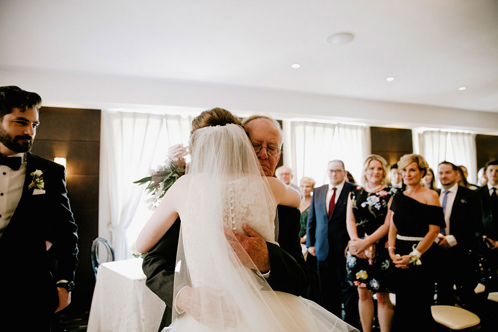 Father embraces daughter at Eglinton Grand Toronto Wedding