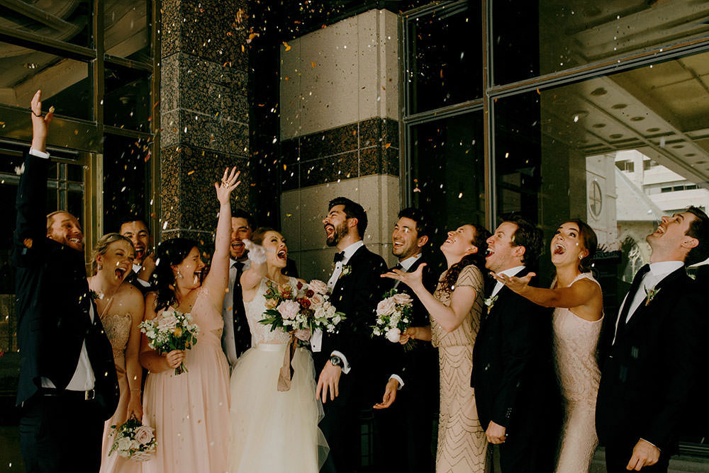 Wedding Party throws confetti in the air in Downtown Toronto wedding