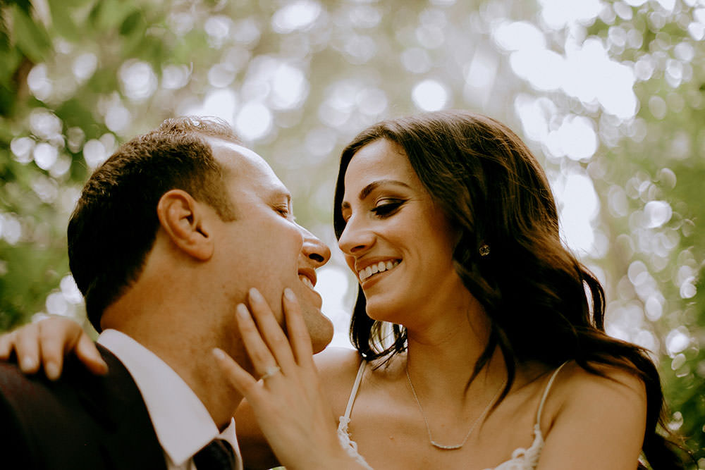 bride and groom in leafy forest ontario wedding photography