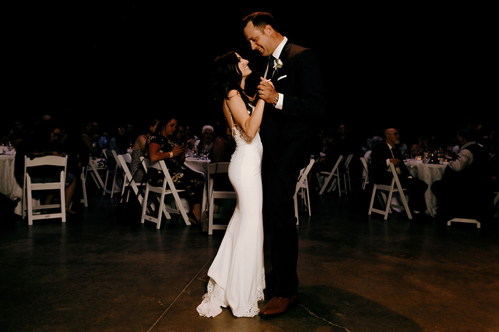 wedding couple having first dance in the science north cavern