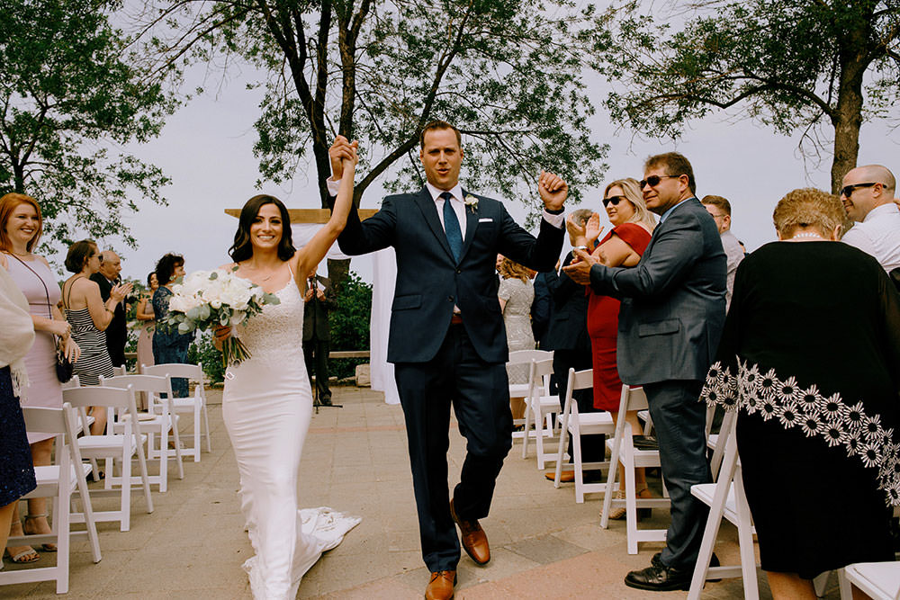 bride and groom walk down aisle ontario wedding photography