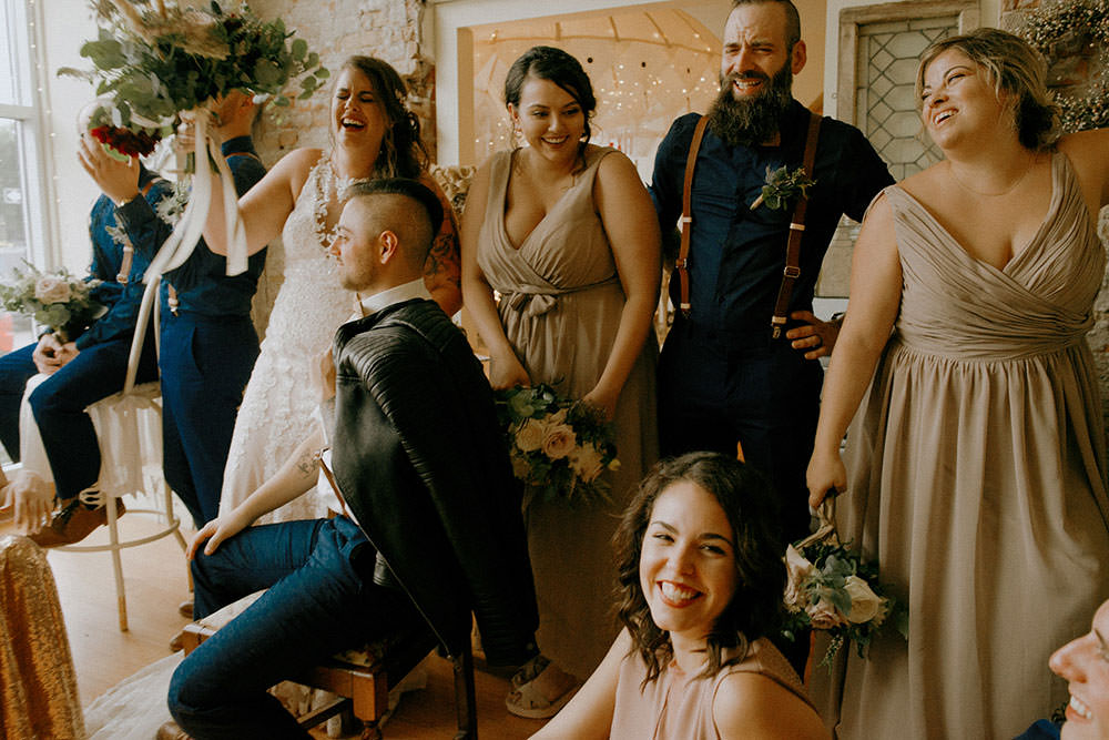 bridal party posing in downtown sudbury cedar nest cafe