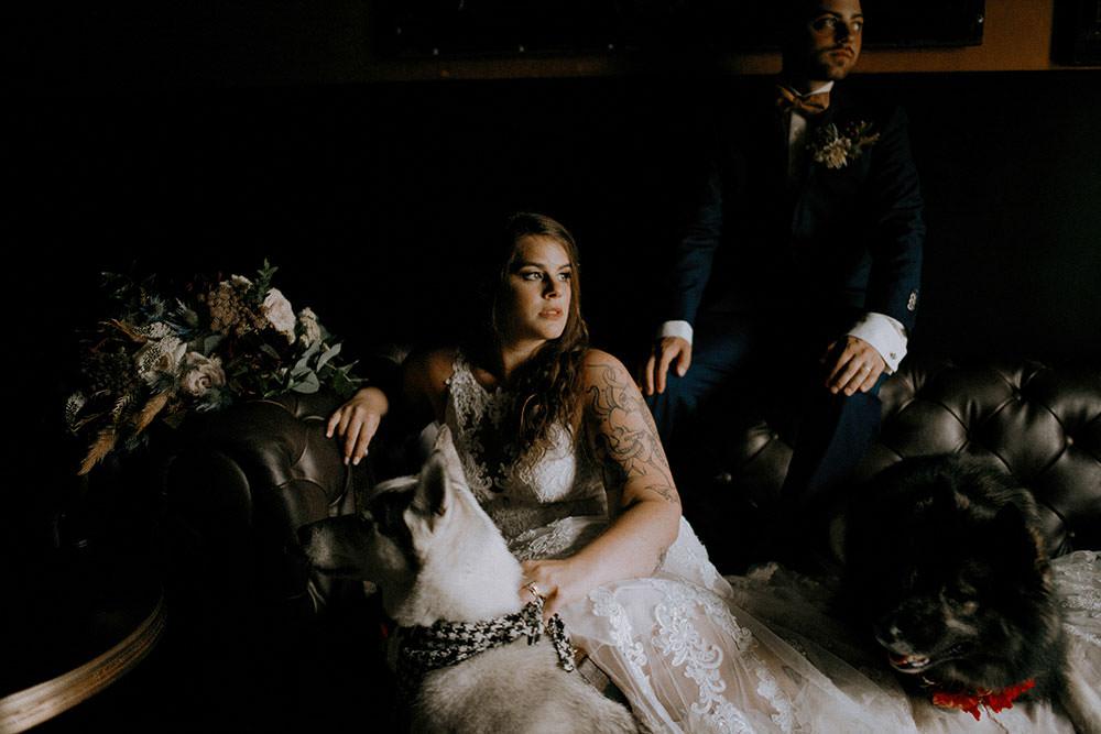 bride and groom posing in the sudbury alibi room