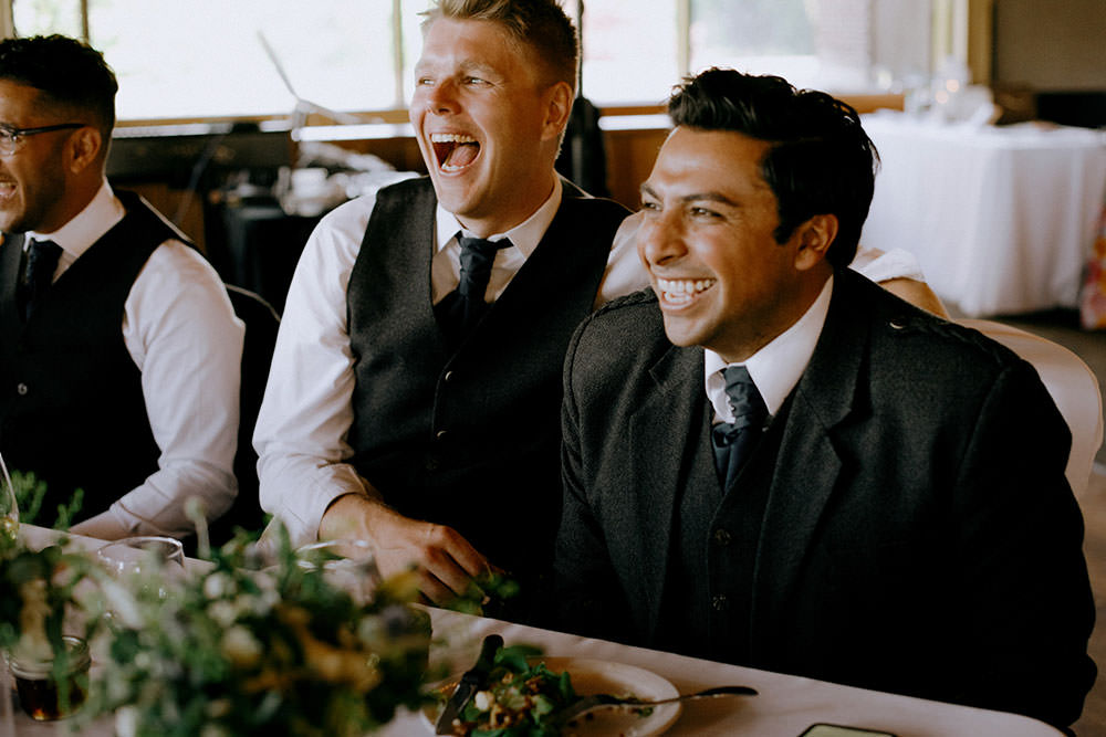 groomsmen laugh at idylwylde wedding
