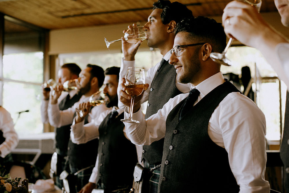 groomsmen cheers at idylwylde wedding