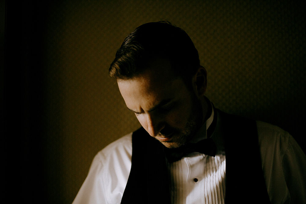 dramatic shot of groom at idylwylde wedding