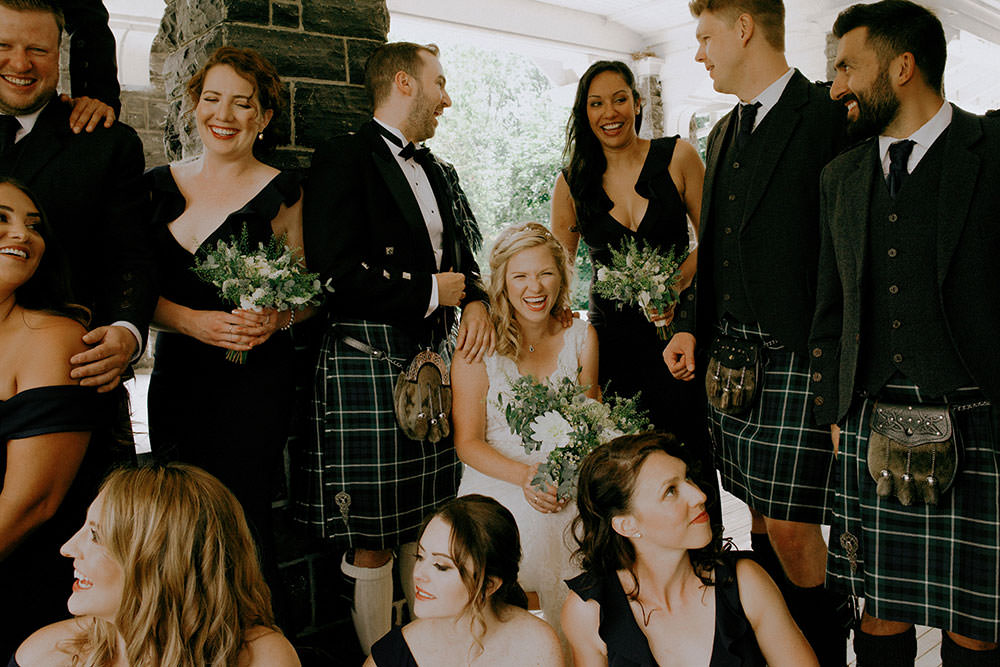 bridal party laughs together at idylwylde wedding
