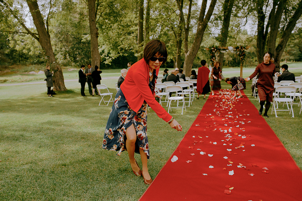 spreading flower petals on the red carpet for the bride at the Brockville Country Club in Brockville, ON