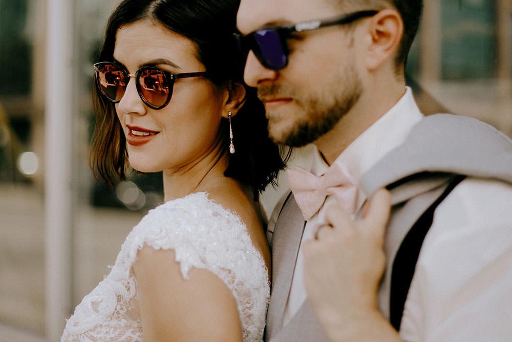 bride and groom posing downtown sudbury
