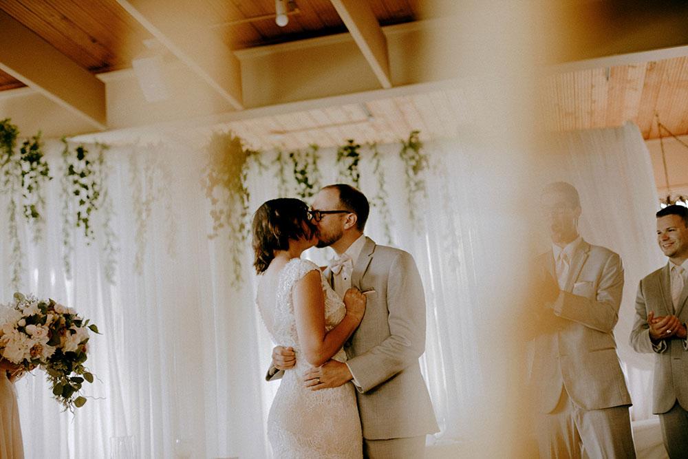 idylwylde wedding bride and groom at altar