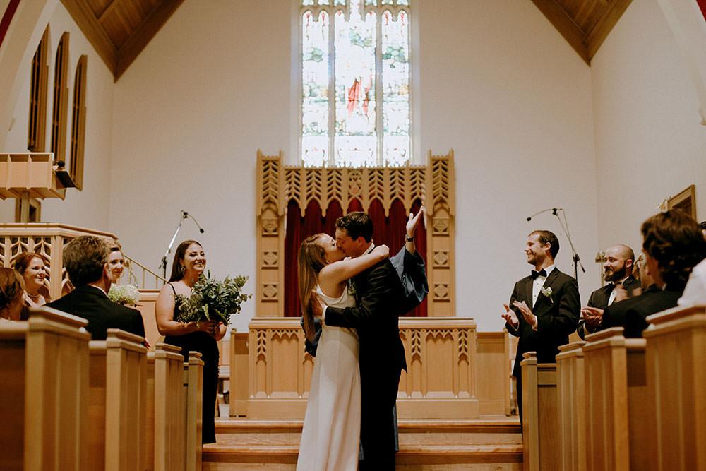 sudbury wedding bride and groom kiss at altar