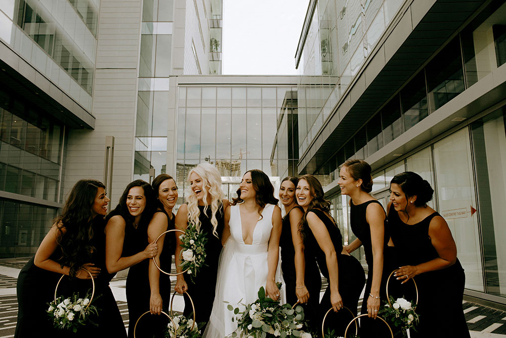 vaughan bride and groom candidly with bridal party
