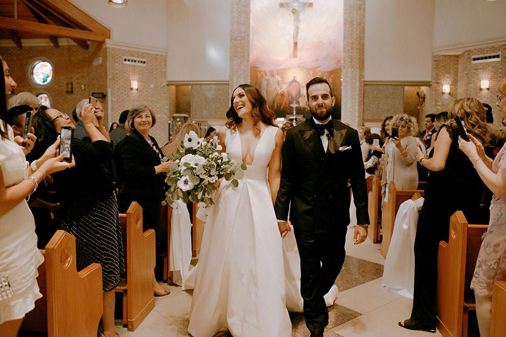vaughan bride and groom walking down aisle