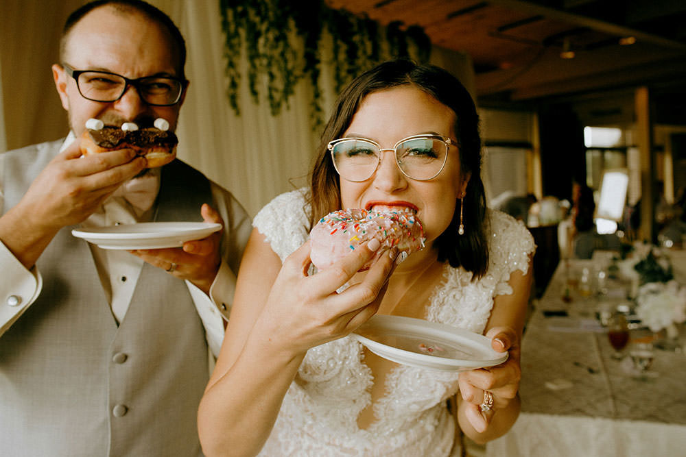 bride and groom eat donuts at sudbury idylwylde