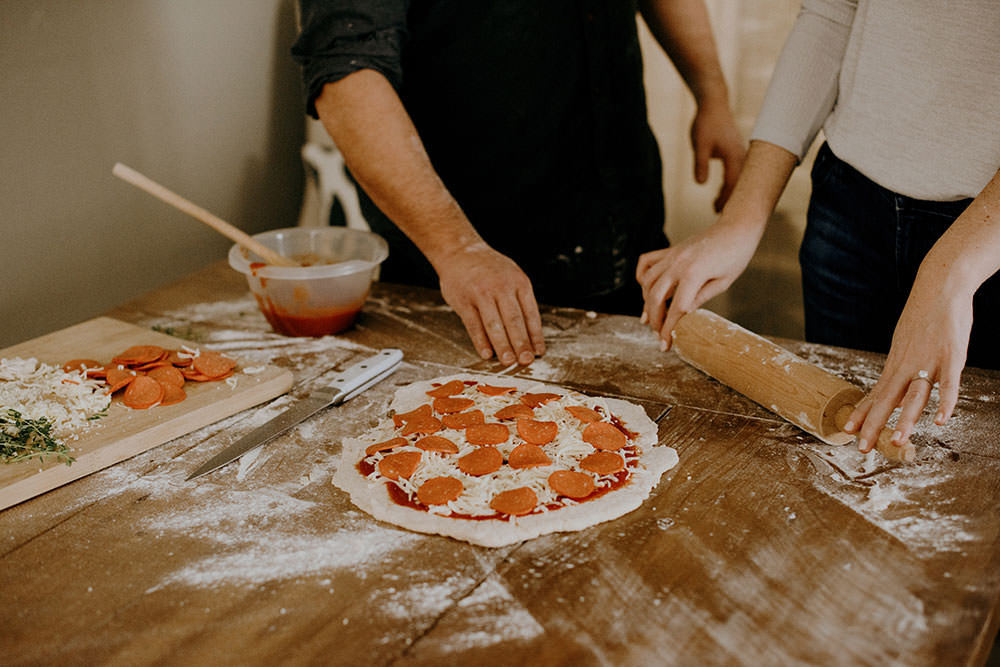 couple makes tasty pizza in ontario engagement session