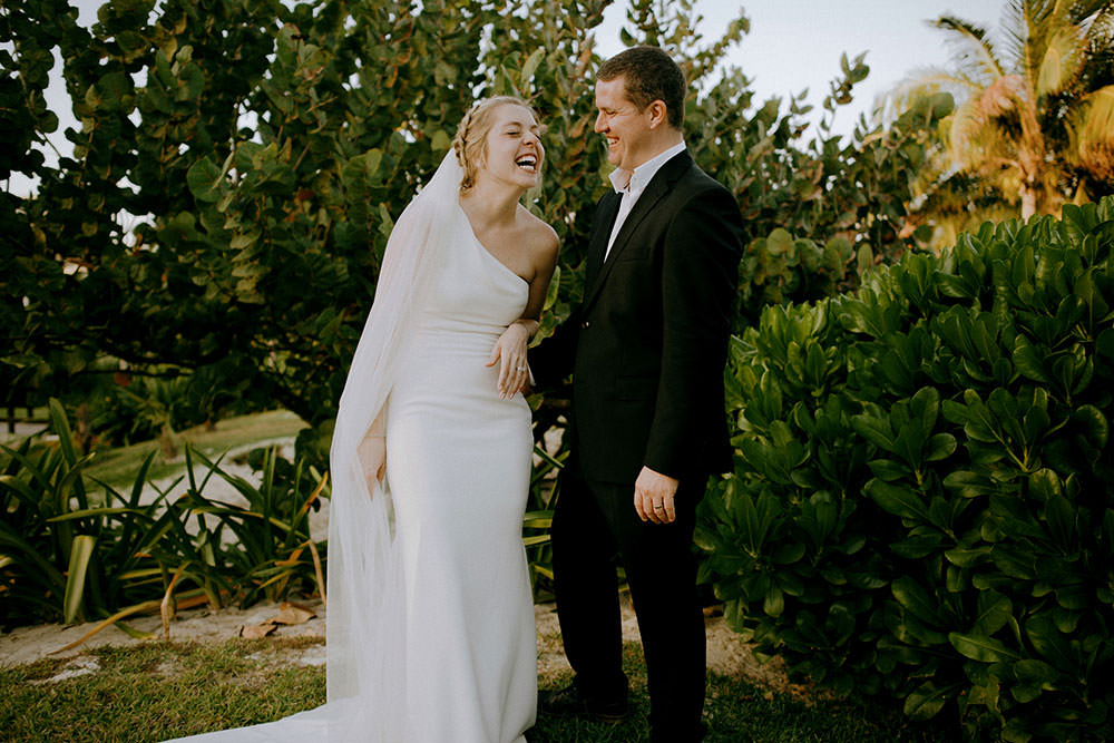 Royalton Riviera Cancun Wedding couple laugh together