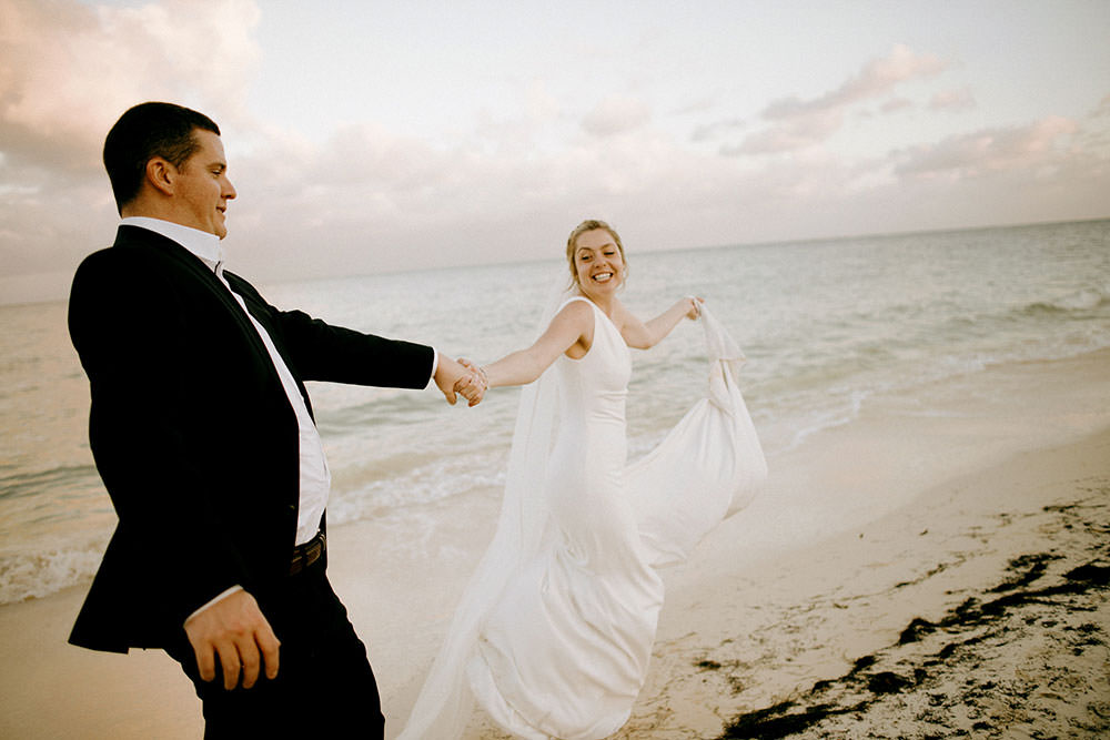 Royalton Riviera Cancun Wedding couple run down beach