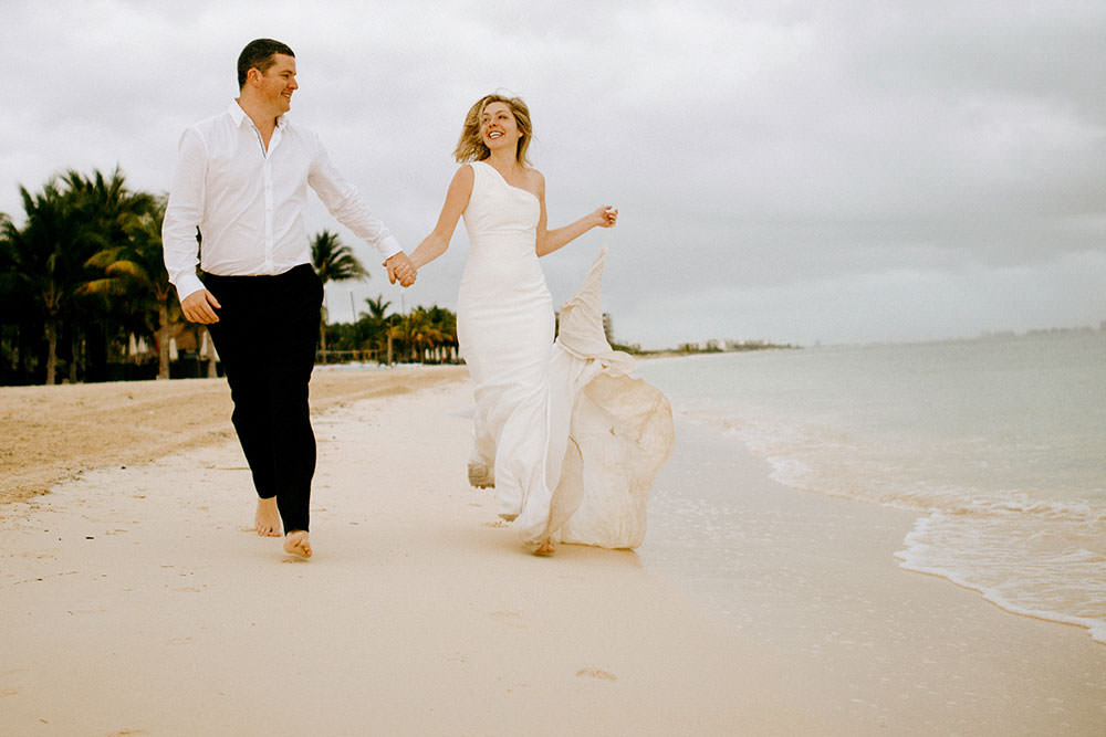Royalton Riviera Cancun Wedding couple run down beach next morning